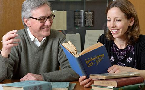 Special Collections Librarian Peter Berg with Professor Helen Veit holding a cookbook